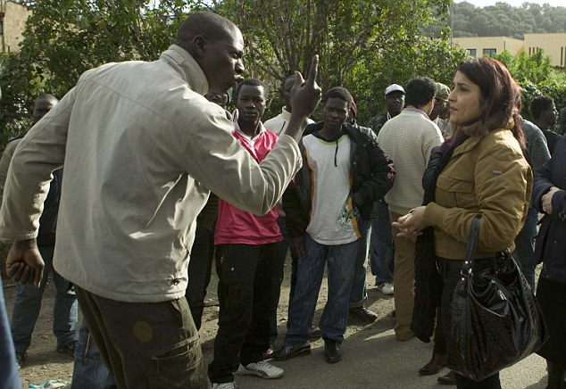 An immigrant argues with a resident during a protest in the Italian southern town of Rosarno